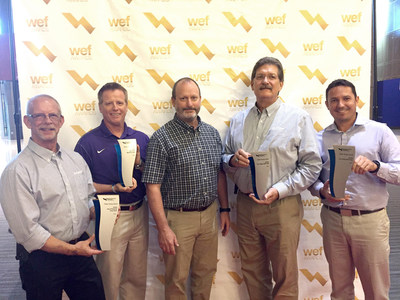 Jacobs project staff and client representatives received the awards at WEFTEC 2018. L to R: Pembroke Pines Project Manager Dan Stark, West Melbourne Project Manager Brian Mascher, City of Pembroke Pines Utility Director Riley Smith, The Villages Project Manager Rock Raiford and City of Key West Utility Director John Paul Castro.