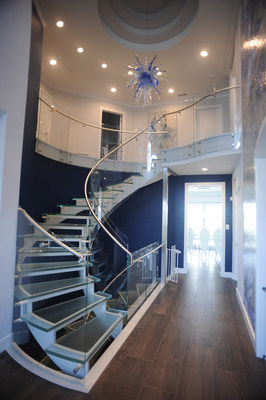 Custom floating grand glass & metal statement staircase.