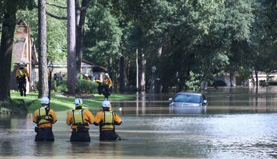 Members of FEMA's Urban Search and Rescue Nebraska Task Force One (NE-TF1) comb a neighborhood for survivors impacted by flooding from Hurricane Harvey