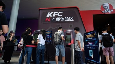 Customers interacting with KFC's AI-powered self-ordering kiosks at Alibaba Cloud's 2018 Computing Conference in Hangzhou