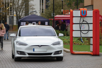 ZAPINAMO 'STREETHUBZ' unit shown here at the University of Warwick. It can easily fit over a standard 3 or 7kW Grid connection to provide a 'Power Boosted' rapid charge up to 50kW, punching well above its weight. Its ergonomic design also lets it fit in space saving corners of car parking bays.