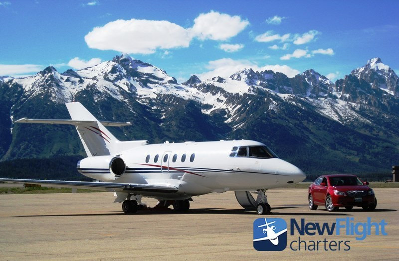 Hawker 800XP jet charter preparing for departure from Jackson Hole Airport with New Flight Charters.