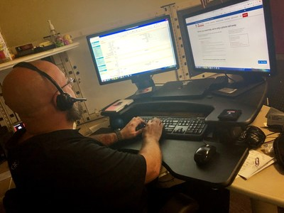 Bob McGrath from Wounded Warrior Project Resource Center takes a call during the center's extended business hours