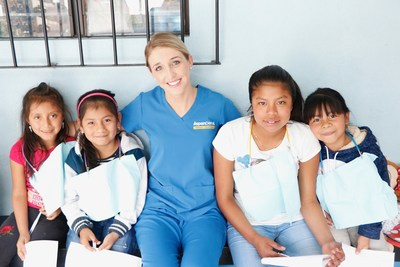 Dr. Savannah Reynolds, Aspen Dental practice owner in Greenville, S.C., takes photos with local kids in Guatemala before providing dental care.