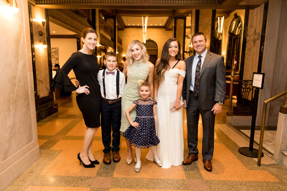 Country duo Maddie & Tae surprise 5-year-old cancer patient Caroline Lantz and her family with a much-needed night away from the hospital to attend the 52nd annual CMA Awards on Nov. 14, 2018, in Nashville, Tennessee, thanks to Aflac – a committed corporate ally in helping defeat childhood cancer. Photo Credit: Sara Kauss Photography