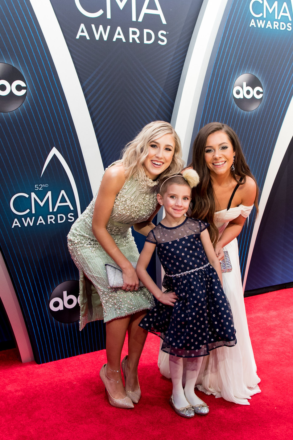 PLATINUM-selling country music artists Maddie & Tae escort 5-year-old Caroline Lantz, a cancer patient at Children's Hospital at Vanderbilt, down the official red carpet during the 52nd annual CMA Awards on Nov. 14, 2018, in Nashville, Tennessee, thanks to Aflac – a committed corporate ally in helping defeat childhood cancer. Photo Credit: Sara Kauss Photography