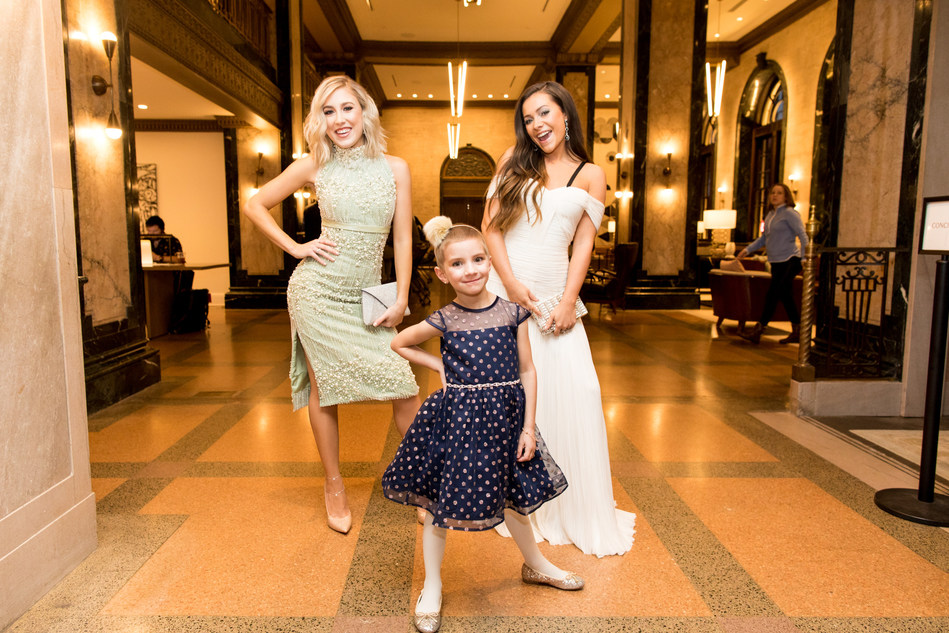 CAPTION: Thanks to Aflac, a committed corporate ally in helping defeat childhood cancer, 5-year-old cancer patient Caroline Lantz shows off her fancy look alongside new friends, country music stars Maddie & Tae, before the CMA Awards on Nov. 14, 2018, in Nashville, Tennessee. Photo Credit: Sara Kauss Photography