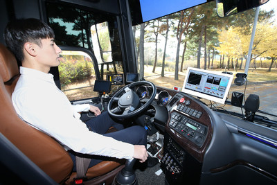 A KT employee is photographed while checking signals delivered to the company's self-driving bus during its test run at Incheon International Airport on November 11.
