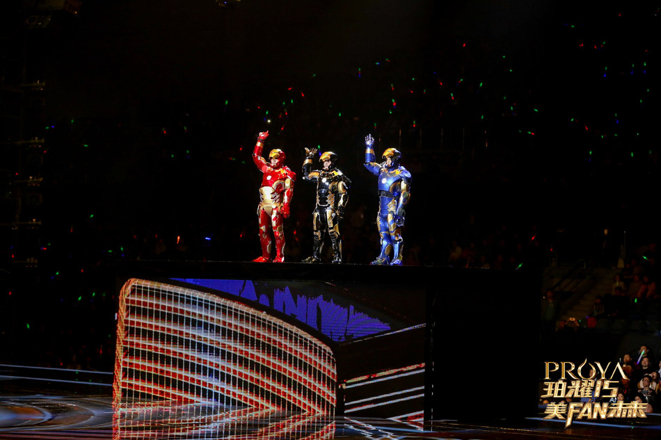 """Proya founders make their entrance decked out in """"Iron Man"""" suits, announcing the formal opening of Proya Tower"""