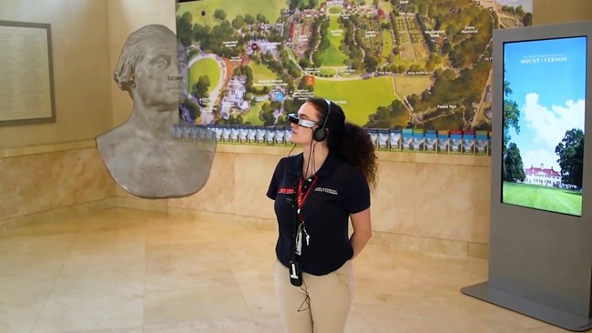 An employee of George Washington's Mount Vernon enjoys a 3D hologram of a sculpture of the 1st US president.