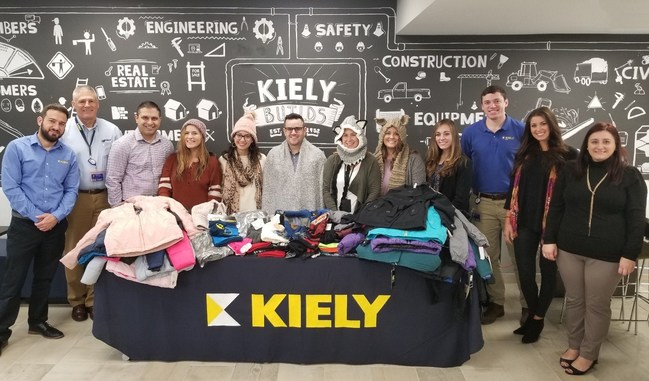 Team Members of the Kiely Family of Companies Corporate Headquarters in Tinton Falls, New Jersey presenting their donation of winter wear for the United Way Warmest Wishes Drive.