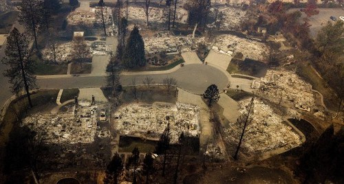 Residences leveled by the Camp Fire line a cul-de-sac in Paradise, Calif., on Thursday, Nov. 15, 2018. (AP Photo/Noah Berger)