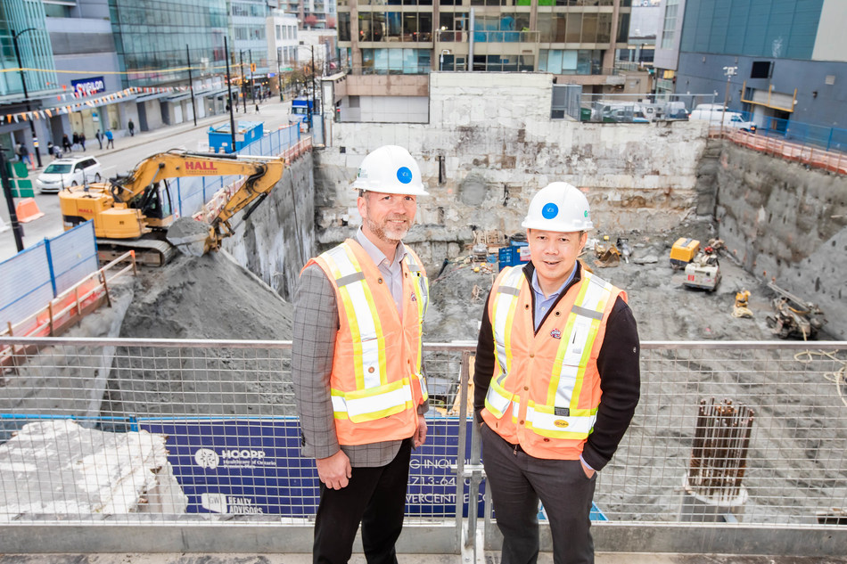 Vancouver mobile game developer, Kabam, has signed a 105,000 sq ft lease in Vancouver Centre II (VCII), an office tower being developed by GWL Realty Advisors. Pictured L-R: Rob Kavanagh and Geoff Heu (GWL Realty Advisors) at the VCII development site. (CNW Group/GWL Realty Advisors)