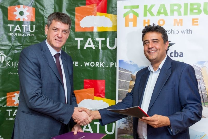 Stephen Jennings Founder and CEO of Rendeavour and Ravi Kohli of Karibu Homes at the signing ceremony to develop 1,000 affordable homes at Tatu City. (PRNewsfoto/Tatu City)