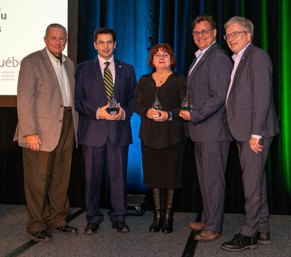 Left to right: Hany Moustapha, Ted Kantrowitz (accepting on behalf of François Mathieu-Potvin), Pierrette Gaudreau, Denis deBlois, Rémi Quirion (CNW Group/Palais des congrès de Montréal)