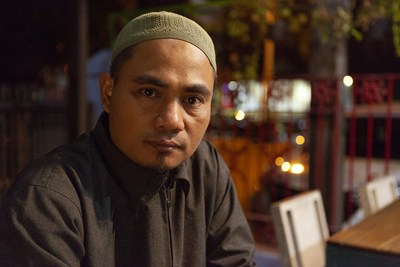 Credit: Orb Media, Photo Identification: Joko Tri Harmanto, Solo, Central Java, Indonesia, Extended Caption: Joko Tri Harmanto helped build the bomb that killed 202 people in Bali in 2002. He has since rejected violence, except in self-defense. Today, he is helping deter others, including his neighbor, Wasiran, from joining violent groups.
