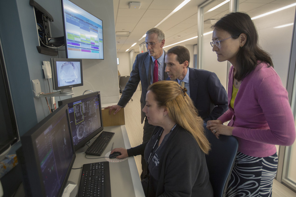 NYU School of Medicine Department of Radiology chair, Michael Recht, MD; Daniel Sodickson, MD, PhD, vice chair for research and director of the Center for Advanced Imaging Innovation and Research; and Yvonne Lui, MD, director of artificial intelligence, watch an MRI exam take place with at NYU Langone Health in New York.