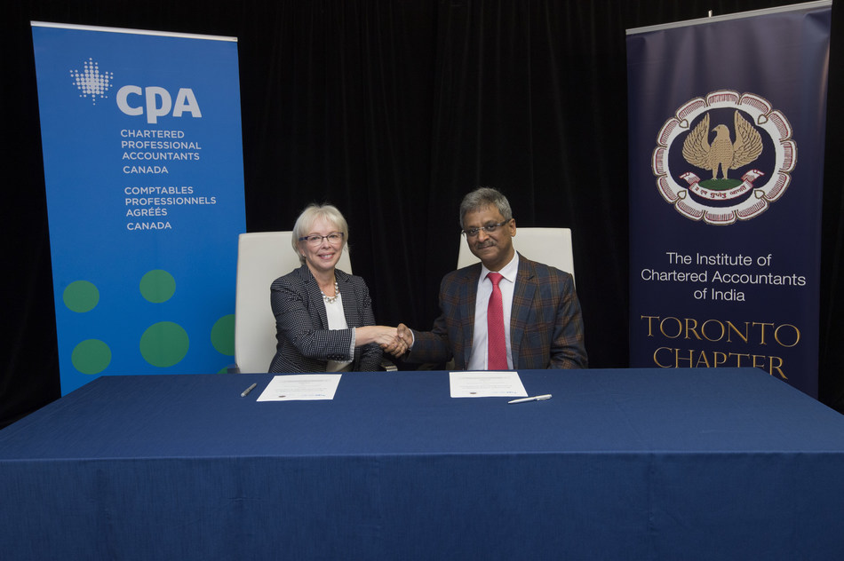 Joy Thomas (left), president and CEO of Chartered Professional Accountants of Canada, and Naveen N. D. Gupta, president of the Institute of Chartered Accountants of India, sign a Memorandum of Understanding between Canada's CPAs and India's CAs in Toronto on November 17, 2018. (CNW Group/CPA Canada)