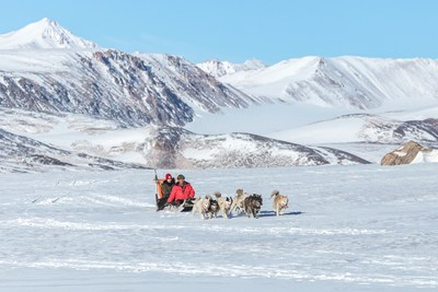 Husky dog sledding in Ittoqqortoormiit, Greenland by Christoffer Collin