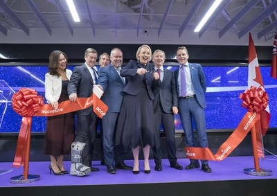 Accenture's North American President & CEO, Julie Sweet cuts the ribbon to open the company's Canada Innovation Hub in Toronto, with (L-R): Managing Director Iliana Oris Valiente, Toronto Mayor John Tory, incoming Canada President Jeffrey Russell, Ontario Minister of Economic Development, Job Creation and Trade Todd Smith, Accenture's Canada President Bill Morris, and CMHC CEO Evan Siddall on Tuesday, November 27, 2018.  THE CANADIAN PRESS IMAGES/J.P. Moczulski (CNW Group/Accenture)