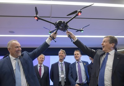 Ontario Minister of Economic Development, Job Creation and Trade Todd Smith, front left,  and Toronto Mayor John Tory hold Accenture's industrial asset inspection drone as (L-R) Accenture's Canada President Bill Morris, incoming President Jeffrey Russell, and CMHC CEO Evan Siddall look on at the launch of Accenture's Canada Innovation Hub in Toronto, Ont. on Tuesday, November 27, 2018. (CNW Group/Accenture)