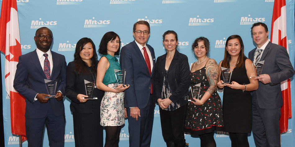 Photo (left to right): The recipients and dignitaries present at the 2018 Mitacs Awards, including Paul Addo, University of Calgary; Grace Quan, Hydrogen In Motion; Lyna Kamintsky, Dalhousie University; Alejandro Adem, Mitacs; the Honourable Kirsty Duncan, Minister of Science and Sport; Rachel Bouserhal, École de technologie supérieure; Emily Giroux, University of British Columbia – Okanagan; and Professor Sébastien Tremblay, Université Laval. (CNW Group/Mitacs Inc.)