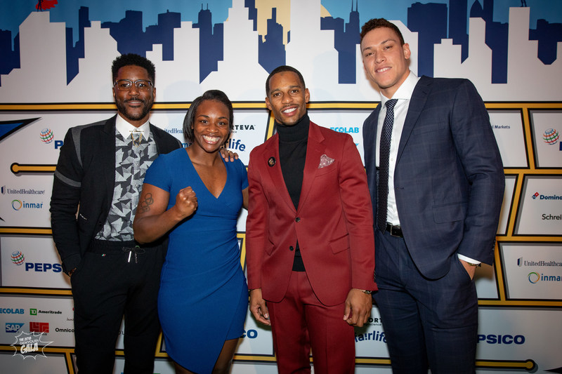 GENYOUth Gala, New York City, November 27, 2018: Keynote panel speakers comprised of CBS and NFL Network TV host and former NFL wide receiver, Nate Burleson, two-time Olympic gold-medalist boxer, Claressa Shields, Super Bowl champion and former New York Giants wide receiver, Victor Cruz, and New York Yankees star, Aaron Judge.