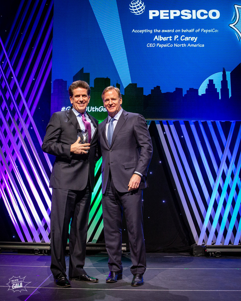 GENYOUth Gala, New York City, November 27, 2018: Commissioner of the National Football League, Roger Goodell, presents the Vanguard Award to Al Carey, CEO, PepsiCo North America, accepting on behalf of PepsiCo.