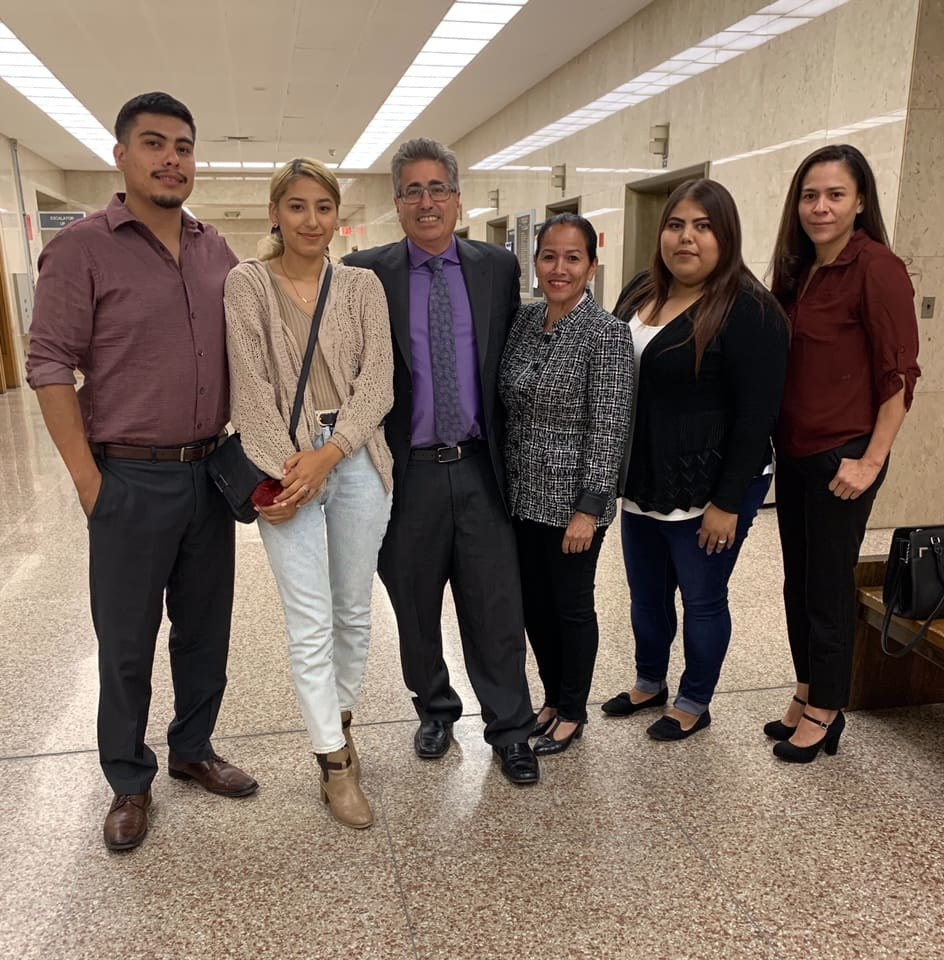 Attorneys V. James DeSimone and Carmen Sabater with the family of Maria Lopez.