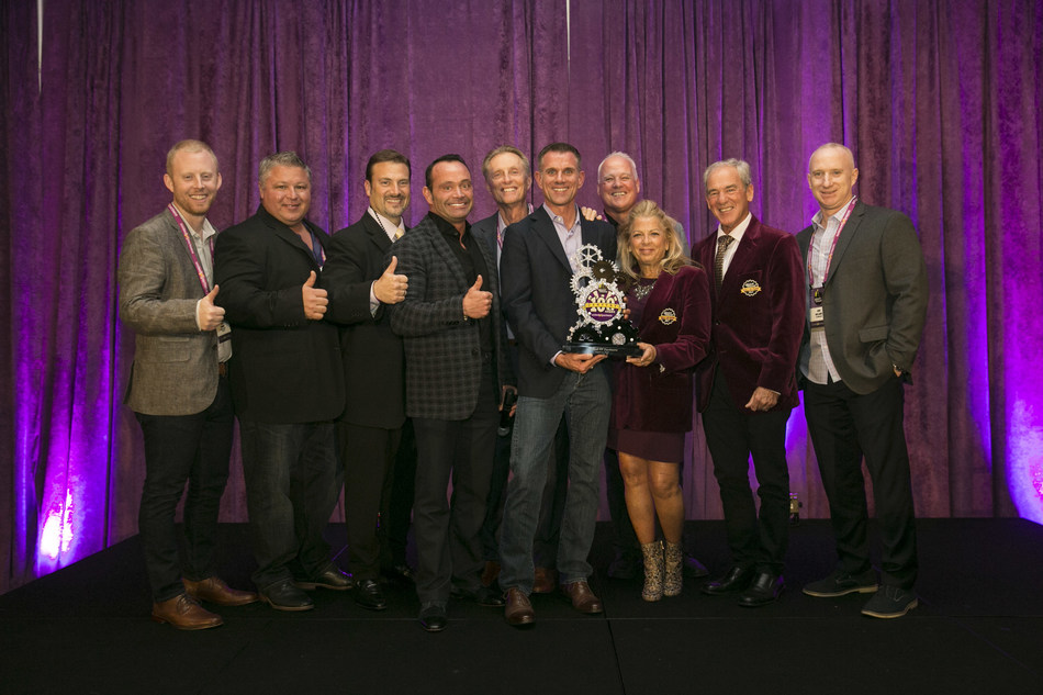 Chris Rondeau, CEO, Planet Fitness, recognizes United PF Partners for 100 club milestone.