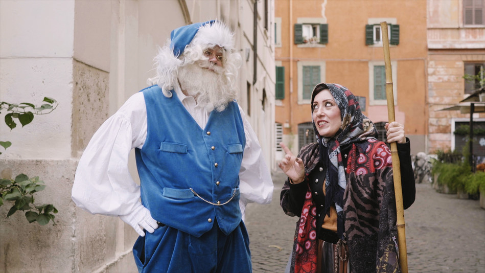 La Befana who delivers gifts and goodies to children on Epiphany Eve with Blue Santa in Italy (CNW Group/WESTJET, an Alberta Partnership)