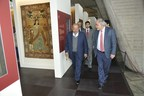 Sheikh Faisal Bin Qasem Al Thani surrounded by VIPs during a tour around the exhibition (PRNewsfoto/The Majlis)