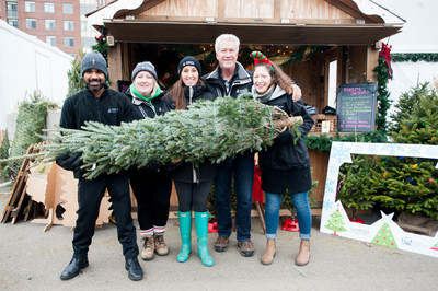Nothing gives Forests Ontario staff a bigger smile than promoting the sale of real, Ontario-grown Christmas Trees! (Right to left: Ravi Singh; Stephanie Prince; Andrea Curley; Rob Keen, CEO; and Ruth Hall) (CNW Group/Forests Ontario)