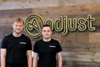 Acquired.io Founders with Adjust logo. Andrey Kazakov (left), Max Gannutin (right) (PRNewsfoto/Adjust GmbH)