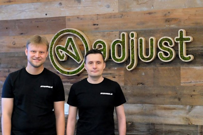 Acquired.io Founders with Adjust logo. Andrey Kazakov (left), Max Gannutin (right)