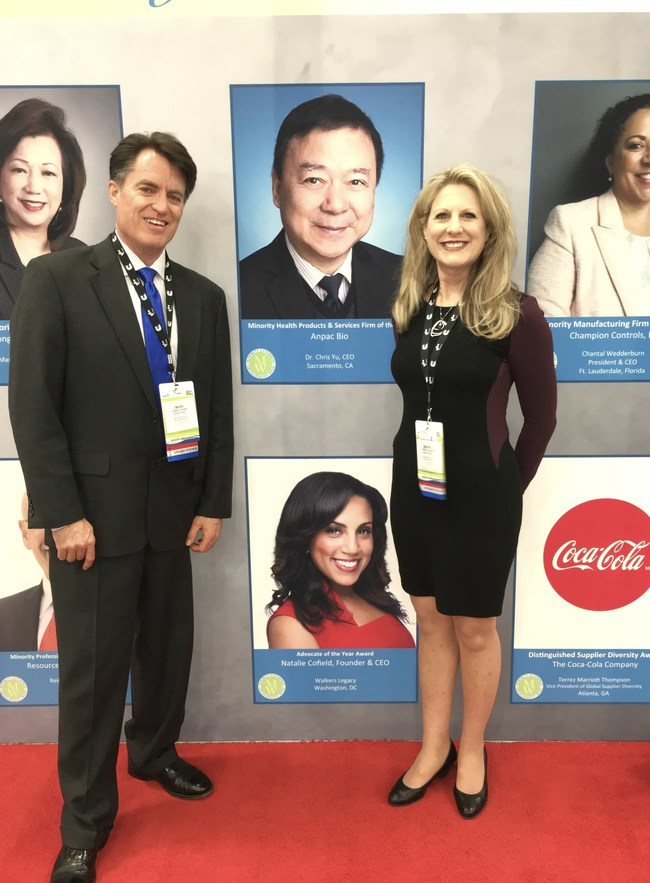"""Anpac Bio-Medical Science Company CFO Mark Luhdorff and CMO Drisha Leggitt flank CEO Chris Yu's photo revealing Anpac Bio's selection as the national, """"2018 Minority Health Products & Services Firm of the Year,"""" at the National Minority Supplier Development Council Conference. The National Minority Business Awards are the highest level of recognition a minority-owned firm can receive from the U.S. Department of Commerce–recognizing Anpac Bio for its innovative health and liquid biopsy services."""