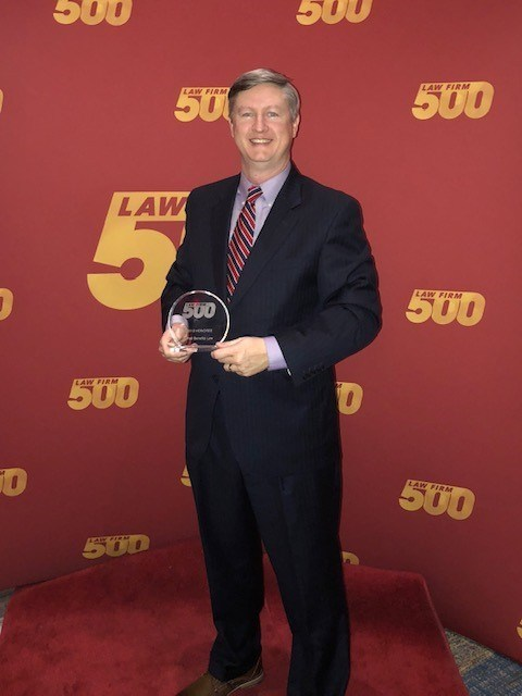 David Hall with the Firm's Law Firm 500 Award