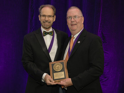 Dr. Carl F. Driscoll (right) receives the 2018 Educator of the Year award from the Immediate Past President of the American College of Prosthodontists Dr. Robert M. Taft (left). This award recognizes exceptional skills as a dental educator and outstanding contributions to academic and professional dentistry.
