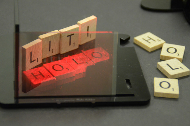 A real hologram make with the Litiholo Hologram Kit showing holographic letter blocks that look almost as real as their non-holographic versions sitting next to them.