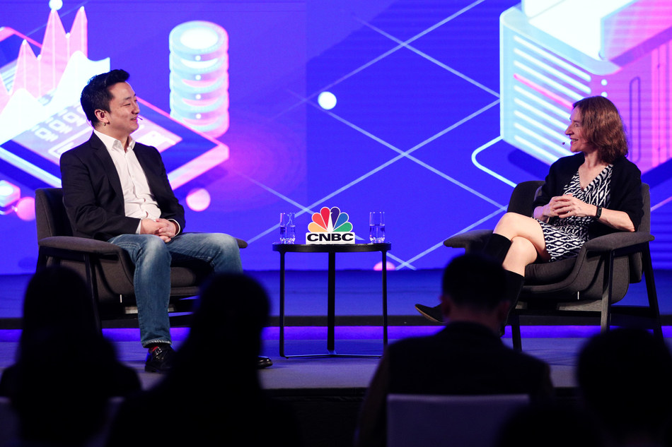 """President of Phoenix Finance Vince Zhang was interviewed by Financial Times correspondent Louise Lucas during a """"fireside chat""""."""