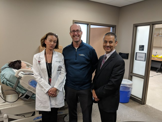 Director of Clinical Research (center) David Keeley and research staff