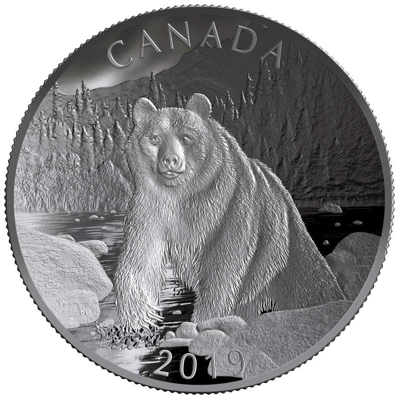 "The Royal Canadian Mint's Fine Silver Double Concave Coin - ""Nature's Grandeur - Brown Bear"" Reverse (CNW Group/Royal Canadian Mint)"