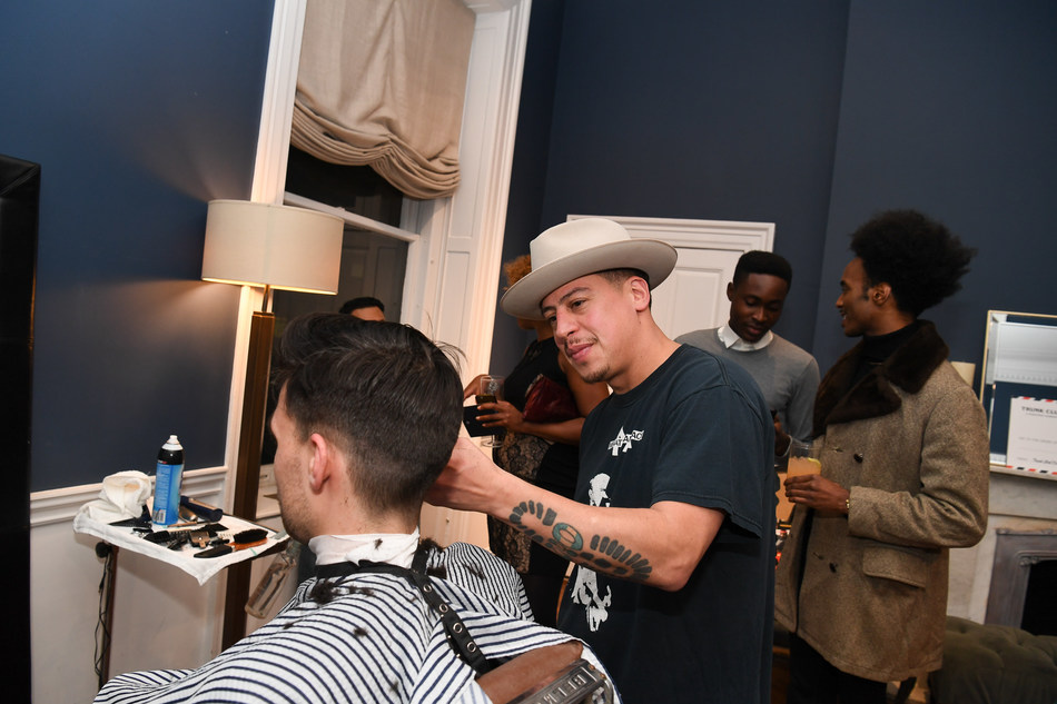 Guests receive complimentary beard cleanup at Trunk Club and Esquire's event benefitting the Movember Foundation