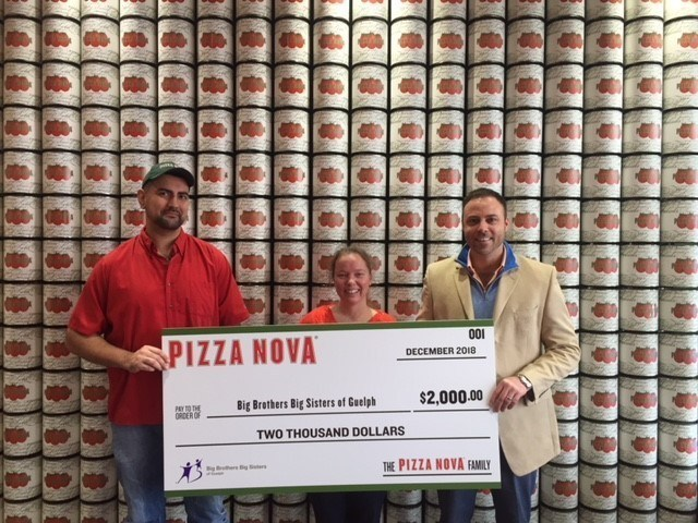 """From left to right: Mangagandeep Brar """"Micky"""", Pizza Nova Franchisee, Jennifer Tremaine, Fund Development Coordinator Big Brothers Big Sisters and Josh Edwards, District Manager Pizza Nova present the proceeds to Big Brothers Big Sisters. (CNW Group/Pizza Nova)"""