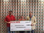 "From left to right: Mangagandeep Brar ""Micky"", Pizza Nova Franchisee, Jennifer Tremaine, Fund Development Coordinator Big Brothers Big Sisters and Josh Edwards, District Manager Pizza Nova present the proceeds to Big Brothers Big Sisters. (CNW Group/Pizza Nova)"