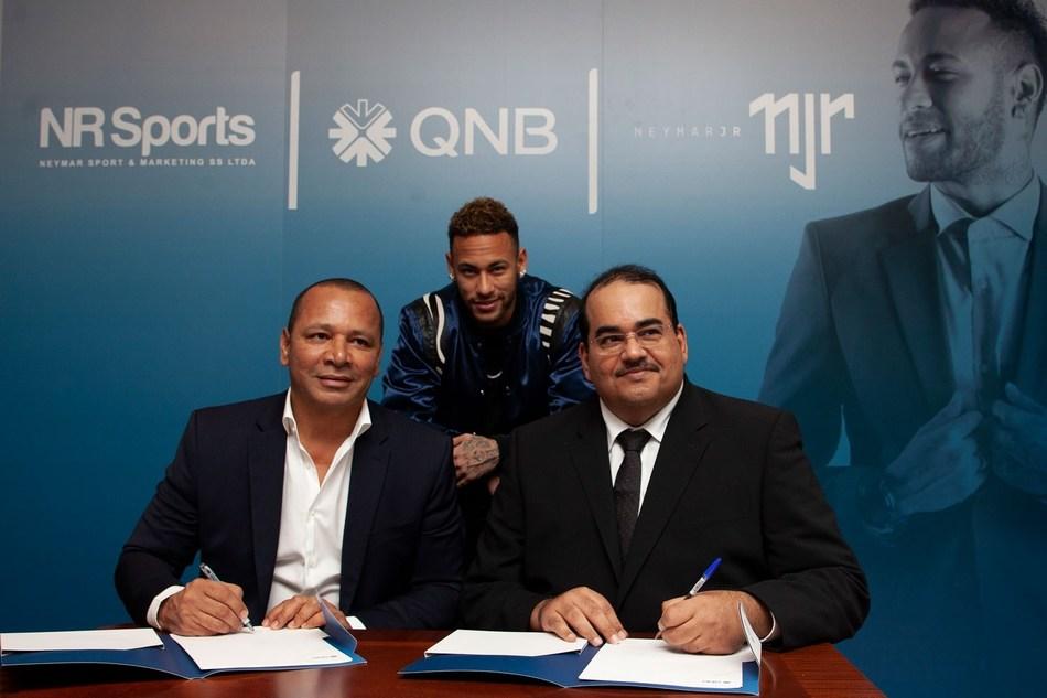 From left to right: Mr. Neymar Silva Santos, Owner of NR Sport & Marketing; Nemar Jr; Mr. Yousef Darwish, General Manager - QNB Group Communications (PRNewsfoto/QNB Group)