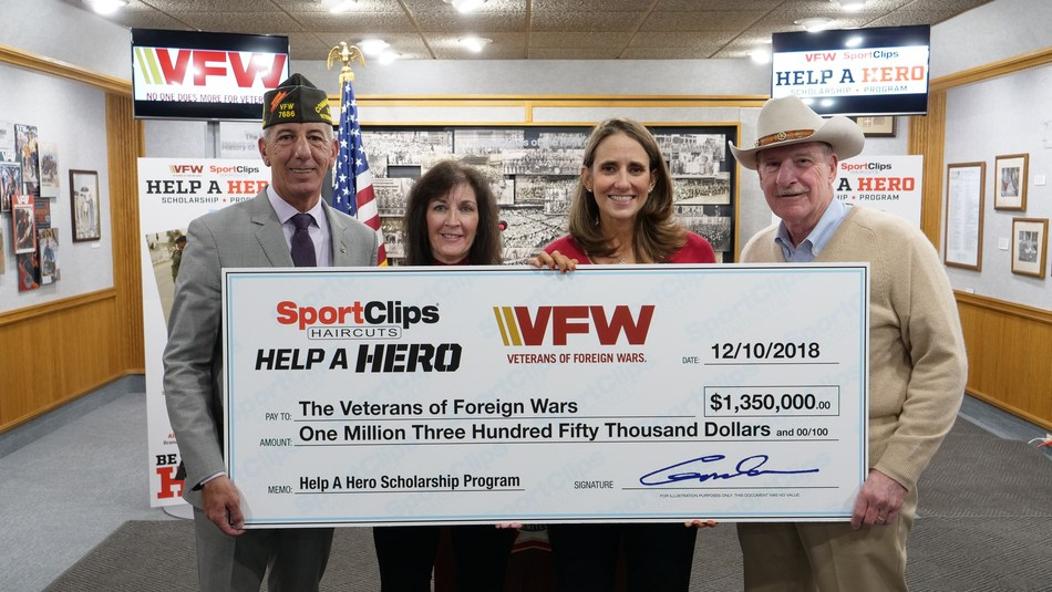 Sport Clips Haircuts just donated $1.35 million to the VFW for Help A Hero Scholarships for veterans. Pictured at the check presentation (l to r) B.J. Lawrence, VFW  Commander-in-Chief; Martha England, Sport Clips Haircuts vice president of marketing; Amanda Palm, Sport Clips Haircuts communications manager; and Gordon Logan, USAF veteran and Sport Clips Haircuts founder and CEO.
