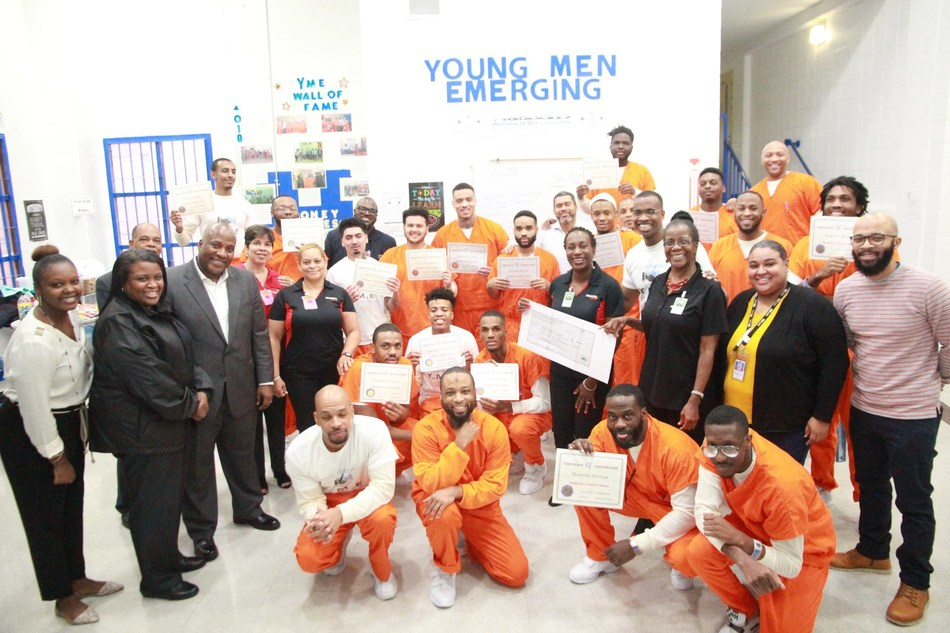 Ceremony for the Young Men Emerging (Y-ME) Unit with Industrial Bank Managers and DC Department of Corrections personnel. (Courtesy of DC Department of Corrections)