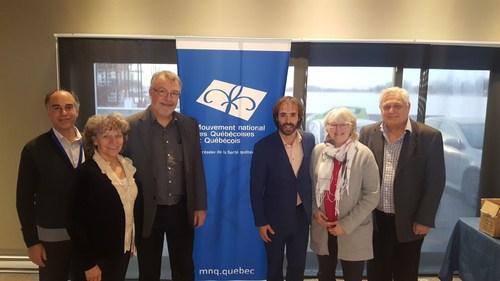 Monsieur Etienne-Alexis Boucher, président du MNQ en compagnie de la Société nationale du Québec à Laval (Groupe CNW/MOUVEMENT NATIONAL DES QUEBECOISES ET QUEBECOIS)