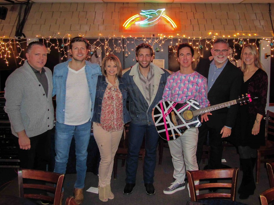 Pictured (l-r): Daniel Miller, Fusion Music and ACM Board member; Jacob Davis; Kele Currier, ASCAP Senior Director, Strategic Services and ACM Board member; Carlton Anderson; JT Harding; Erick Long, ACM SVP, Events; Erika Wollam Nichols, GM, The Bluebird Café. Credit: Bluebird Cafe